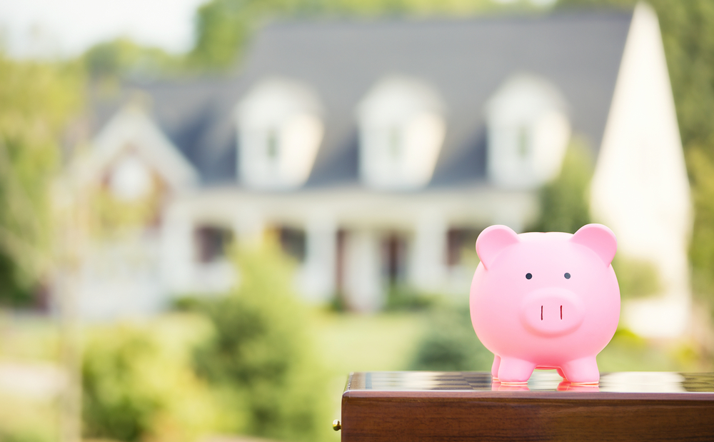 A piggy bank is shown in front of a home. The CFPB has rescinded seven policy statements giving banks temporary flexibility amid the pandemic.