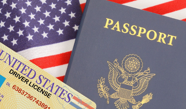A passport and driver's license against a U.S. flag. ID validation is a key part of a remote online notarization (RON).