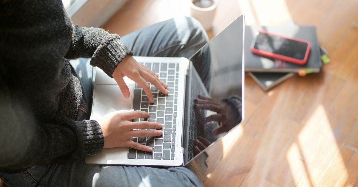 A person uses their laptop; remote online notarization (RON) closings can be conducted from your laptop.